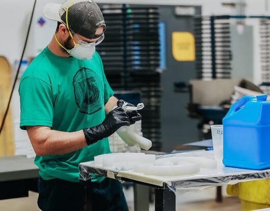 A Burton employee who used to make snowboards shifted to fabricating face shields for hospital workers at the company's 10,000 square-foot prototyping facility in Burlington, Vermont. COURTESY OF BURTON SNOWBOARDS